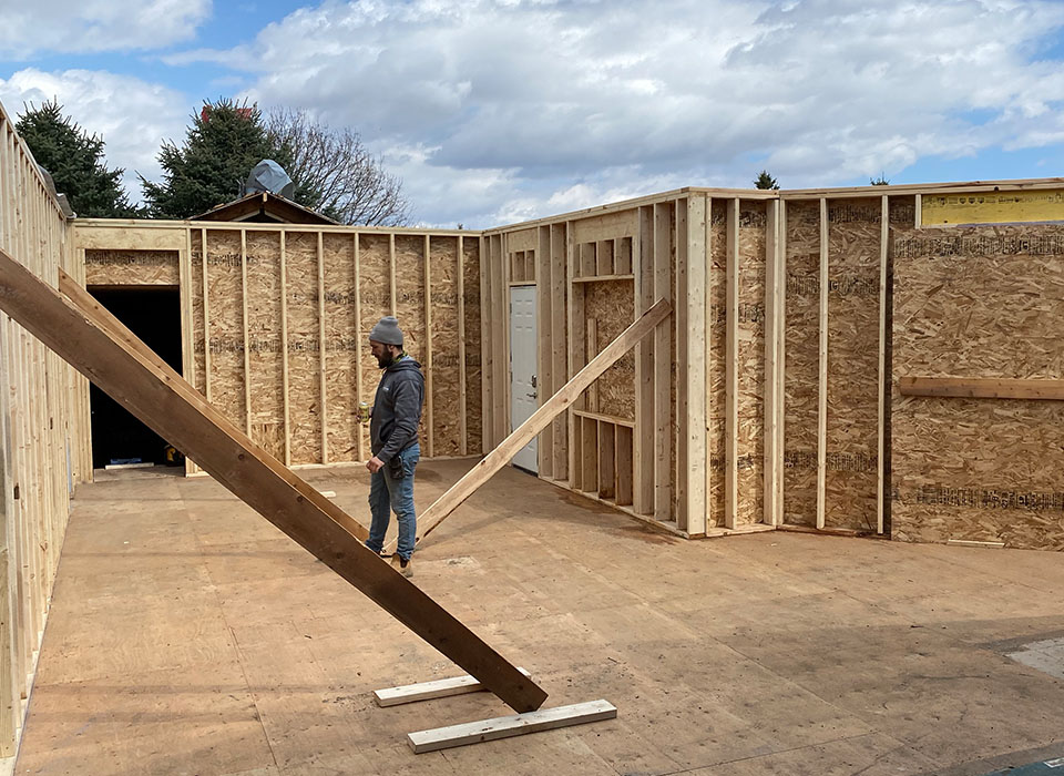 Pro Home workers framing a house